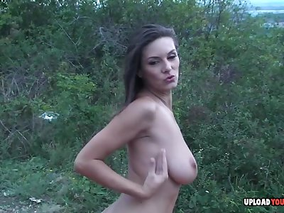 Irresistible 18-year-old strips and pleasures herself outdoors